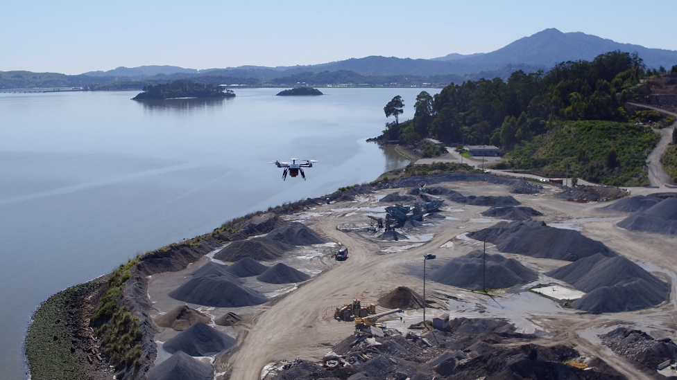 Drone flying above building site