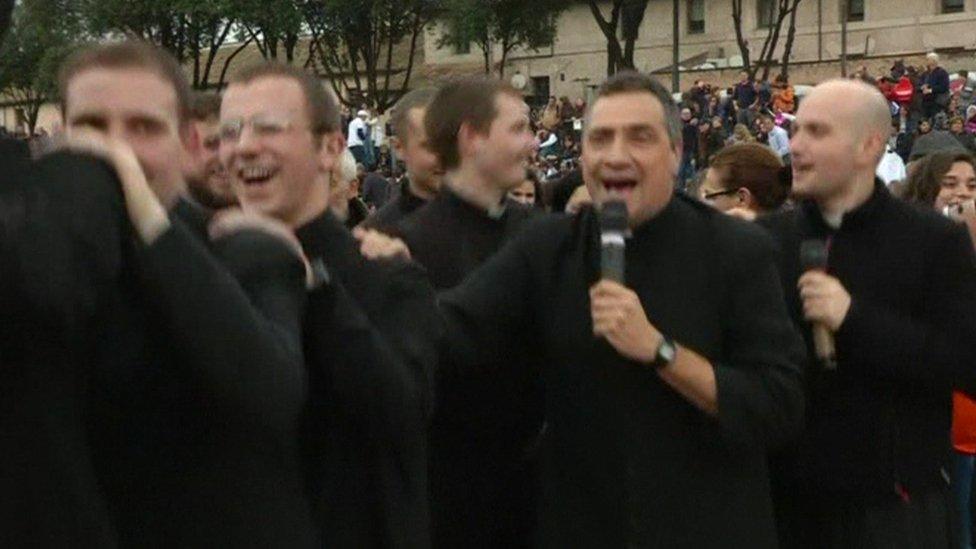 Catholic priests dance the conga at a anti same-sex union rally