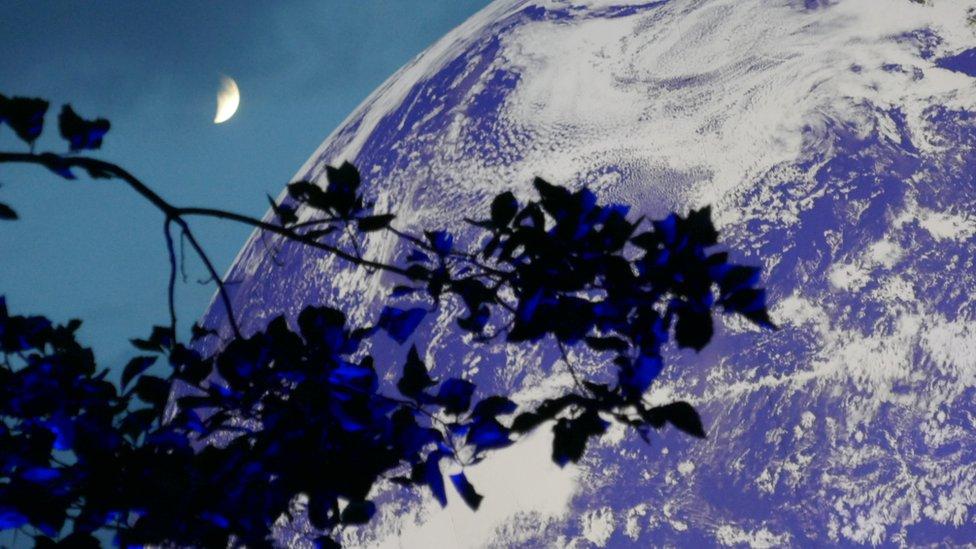 Moon artist Luke Jerram unveils giant Earth sculpture