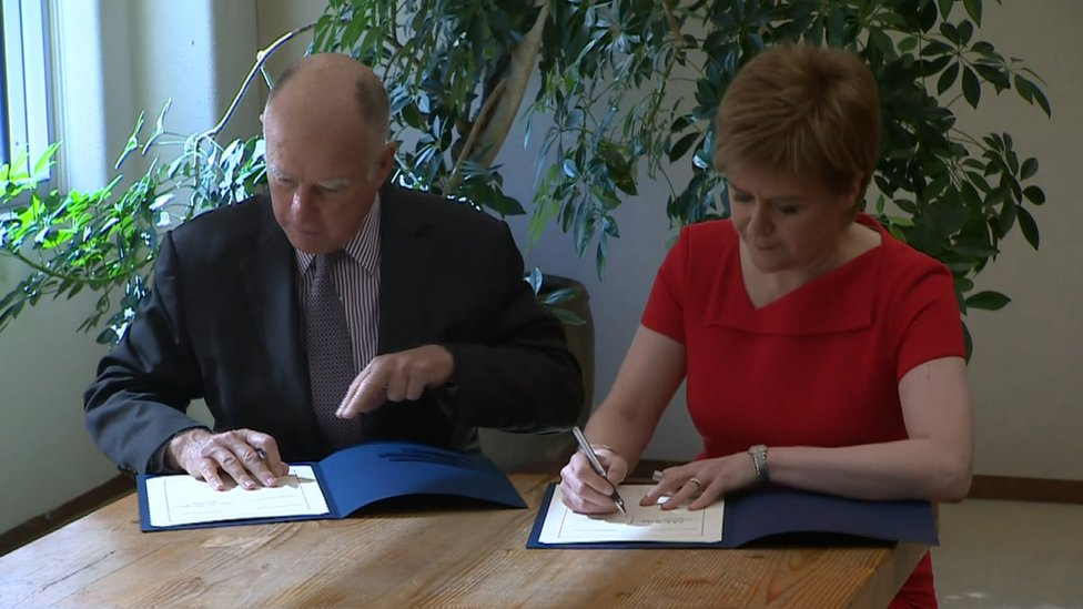 Jerry Brown and Nicola Sturgeon signing agreement