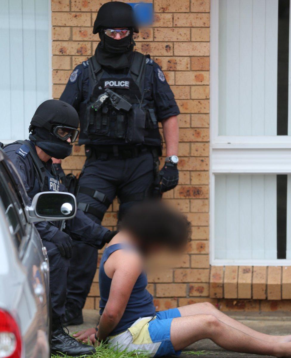Police arrest two suspects in terror raids
