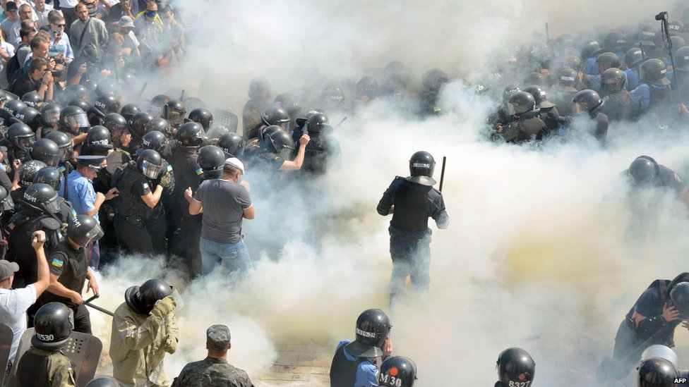 Smoke engulfs police and protestors outside parliament