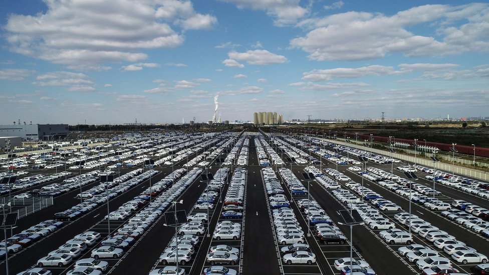 This photo taken on October 11, 2018 shows new BMW cars lined up at a BMW factory in Shenyang in China's northeastern Liaoning province.