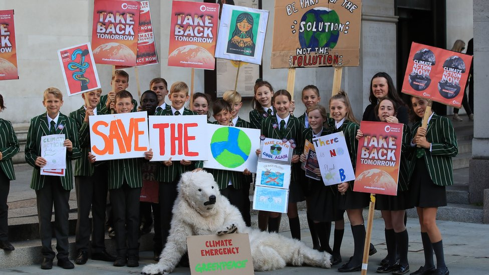 Children from Terra Nova Secondary in Cheshire attend the UK Student Climate Network's strike in Manchester
