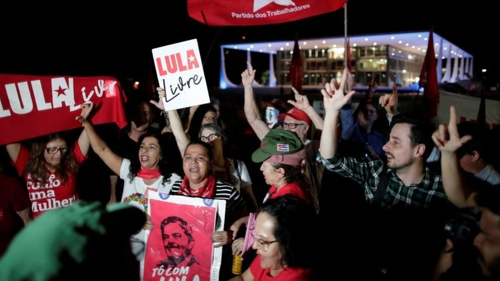 Supporters of Brazil's former president Luiz Inacio Lula da Silva protest outside the Supreme Federal Court
