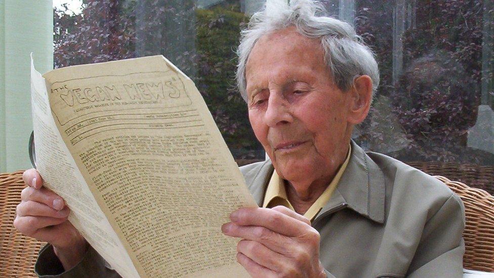 Donald Watson reading a copy of Vegan News