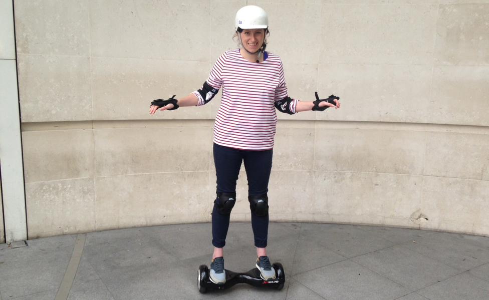 Emma just outside NBH Entrance on a hoverboard