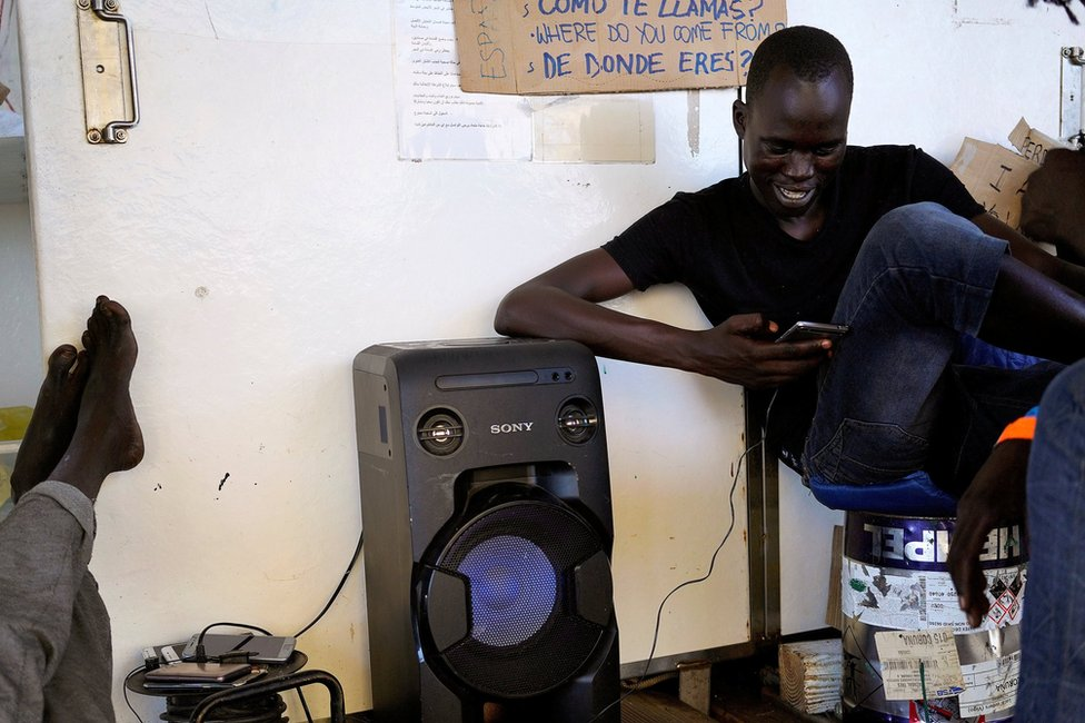 Chuol, 17, from Sudan, listens to the music on board NGO Proactiva Open Arms rescue boat in central Mediterranean Sea