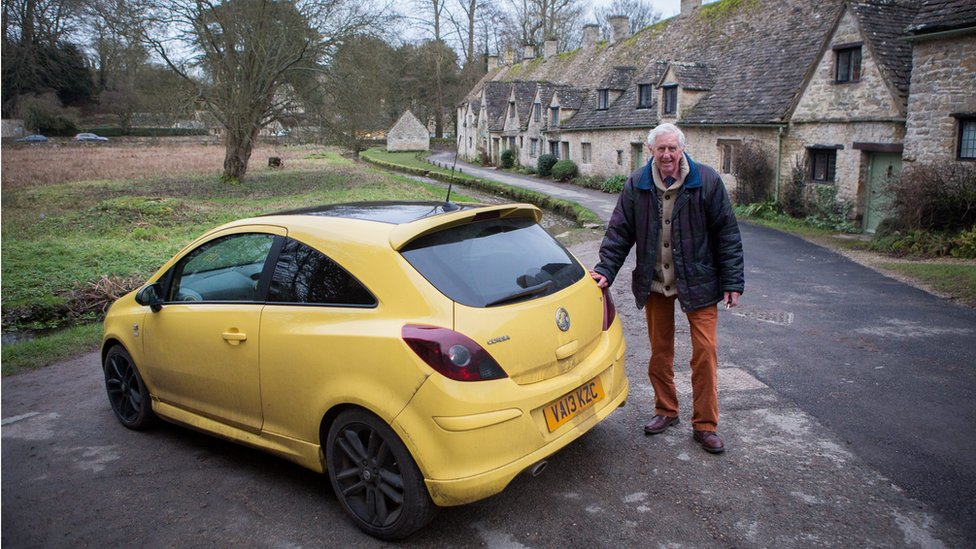 Peter Maddox and his yellow Vauxhall Corsa