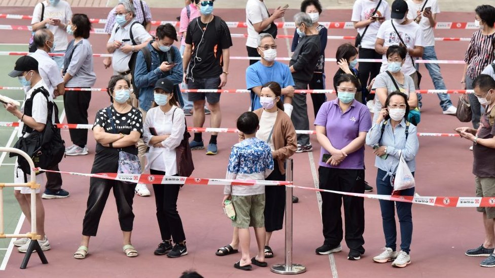 People line up for coronavirus testing at a temporary testing centre in Hong Kong on 9 November