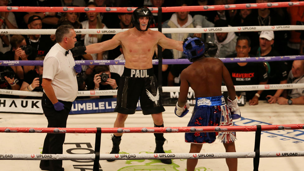Logan Paul taunting KSI in the boxing ring