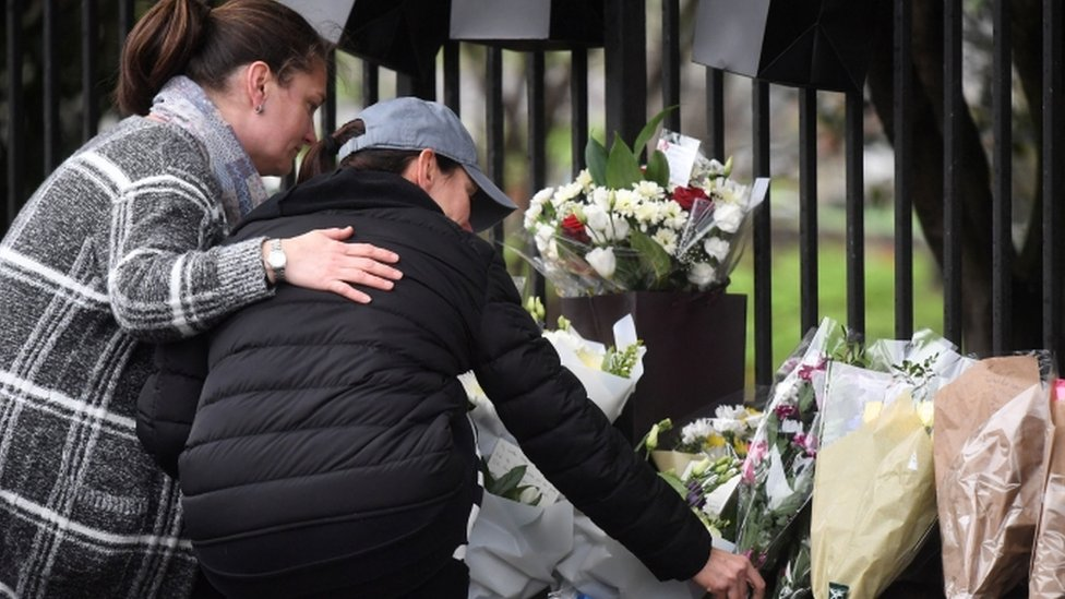 People pay tribute to the three boys