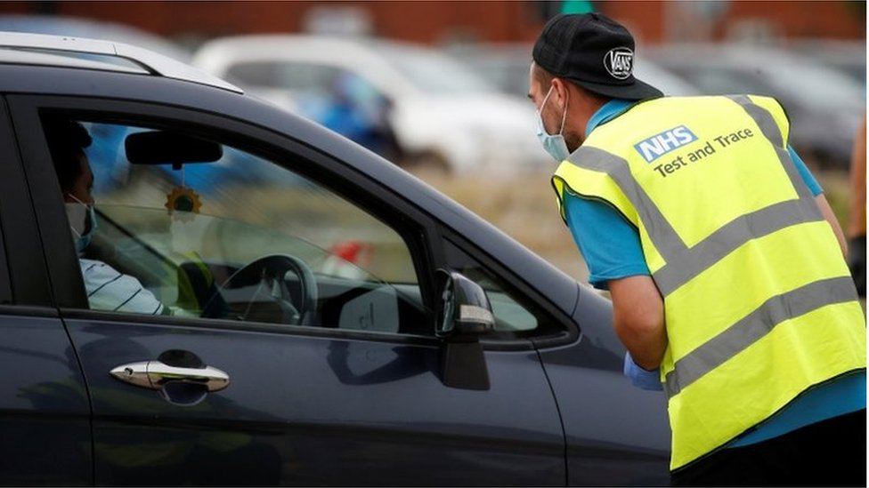 A man arrives at a drive-through test facility following the outbreak of the coronavirus disease (COVID-19) in Bolton