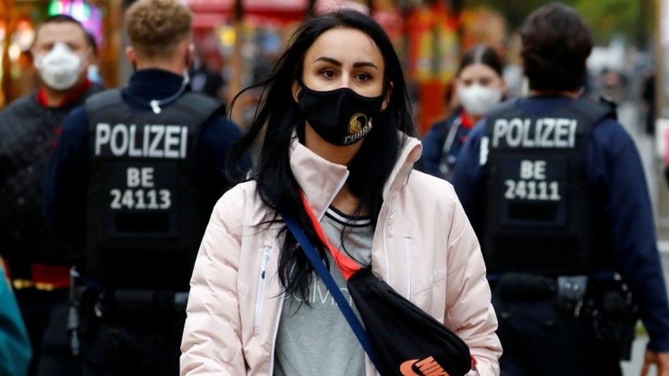 Police officers check the people wearing face masks at Wilmersdorfer Strasse shopping street, as the coronavirus disease (COVID-19) outbreak continues, in Berlin, Germany, October 26, 2020