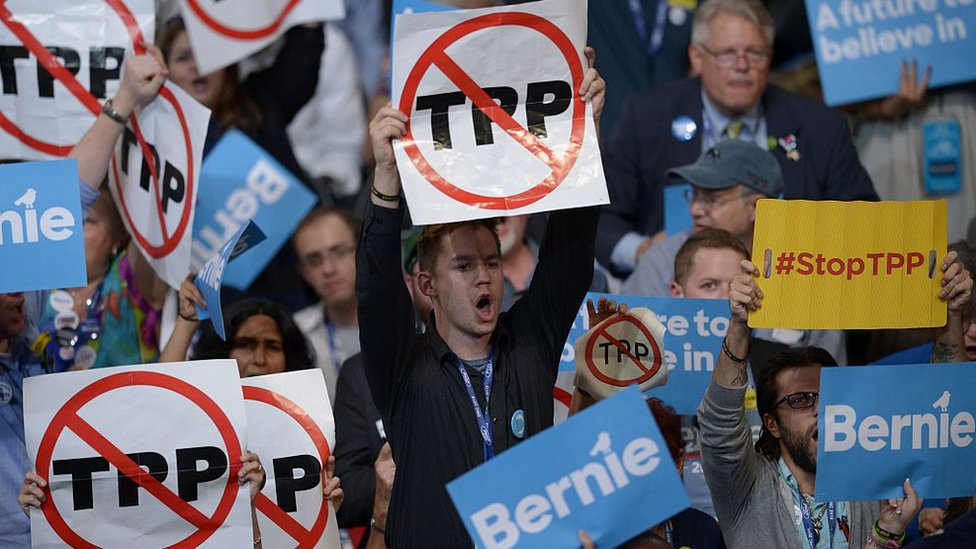 Delegates hold anti-TPP signs at the Democratic Party's convention in Philadelphia, Pennsylvania, 25 July 2016