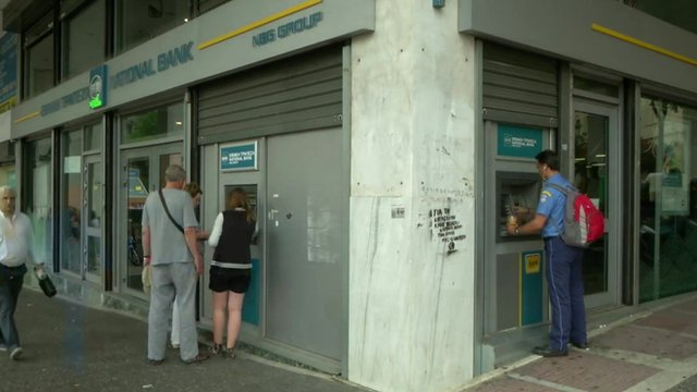People withdrawing cash