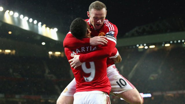 Manchester United forward Wayne Rooney celebrates scoring against Swansea City with Anthony Martial