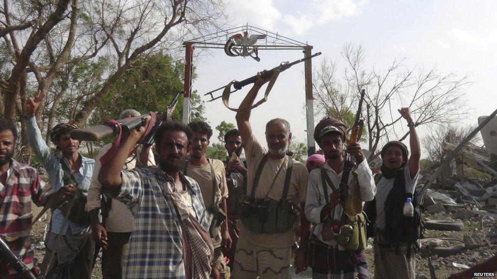 Fighters loyal to Yemen's President Hadi near the al-Anad air base