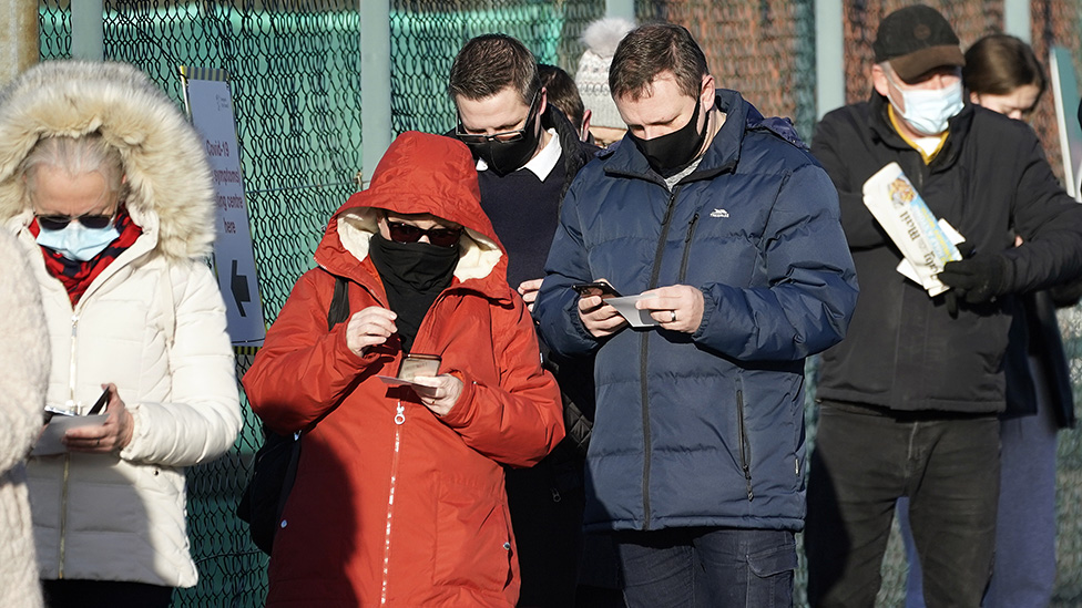 Members of the public queue at a mass Covid-19 testing site in the Liverpool Tennis centre at Wavertree Sports Park on 5 January.