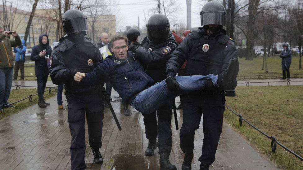 Officers from the Russian interior ministry detain a protester in St Petersburg, April 29, 2017.