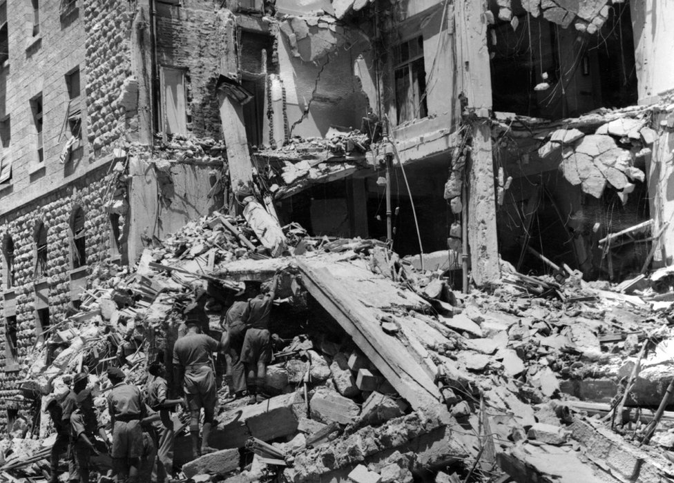 British soldiers dig their way through the debris in search of survivors at the King David Hotel in Jerusalem, Palestine