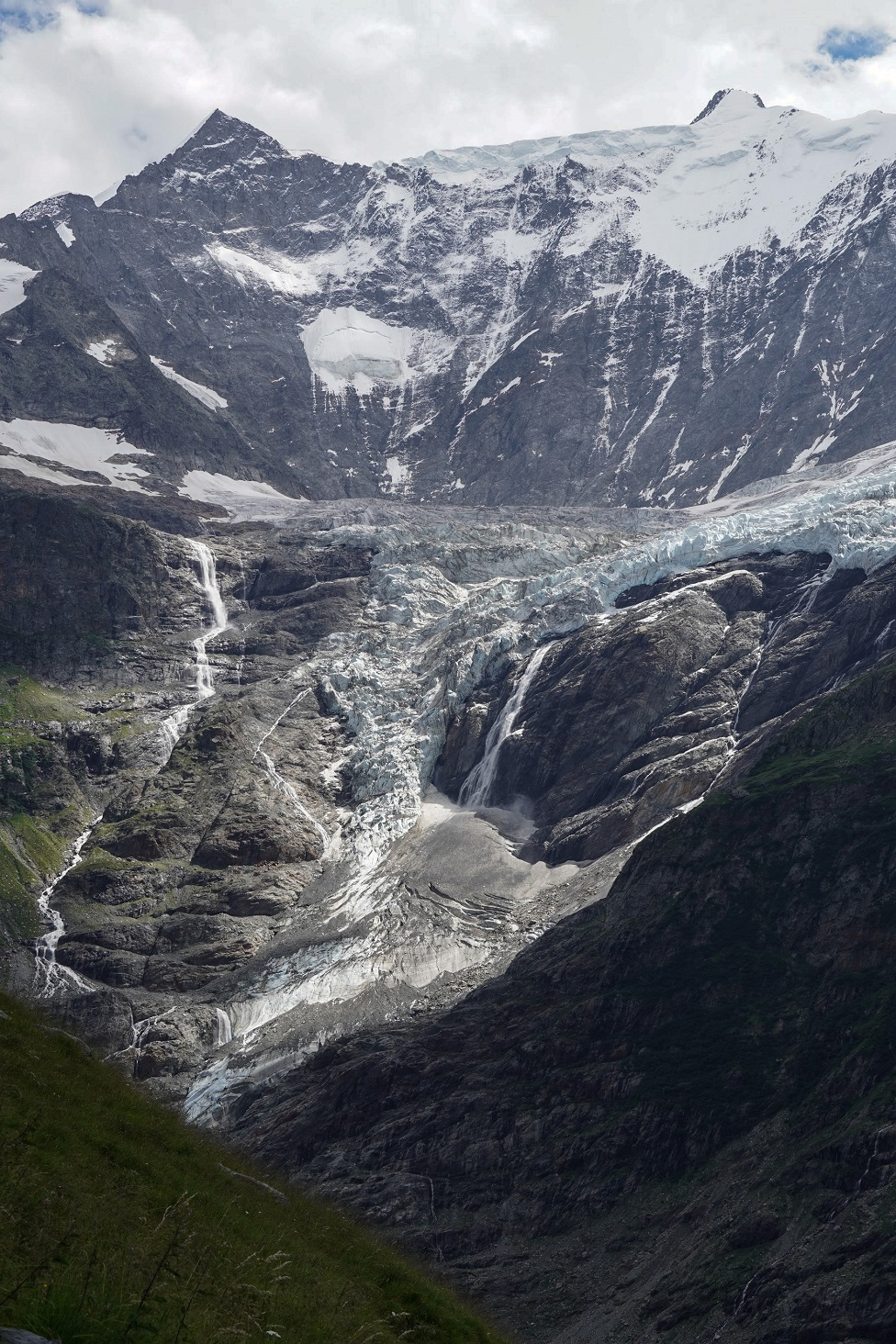 An view of a deep gorge and a glacier