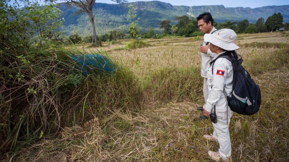 UXO team marking evidence of cluster munitions (December 2014)