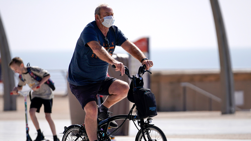 A man cycling in Blackpool
