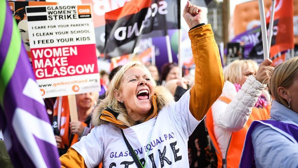 Thousands of women marched in Glasgow in one of the UK's biggest equal pay strikes.