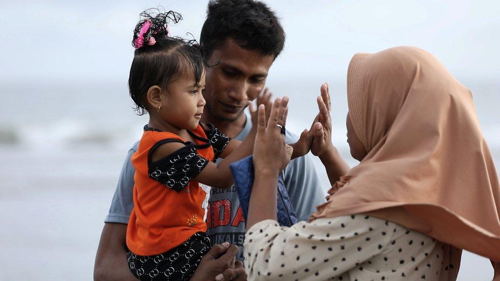 Ali Jasmin with his family on Kuta beach