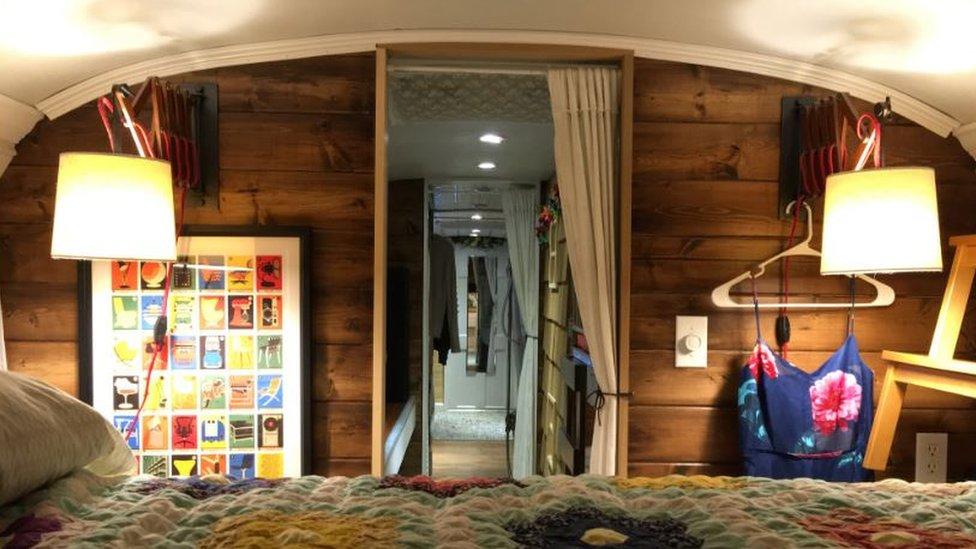 Master bedroom inside a school bus