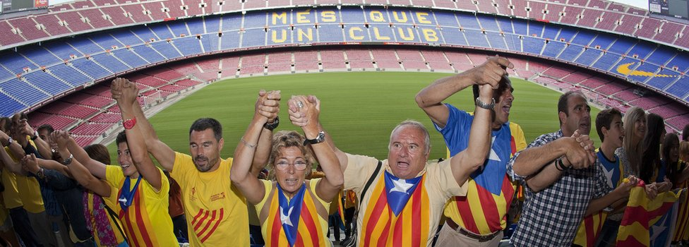 Catalans link arms in a bid to create a 400-kilometre (250-mile) human chain, part of a campaign for independence from Spain during Catalonia National Day, or Diada, at FC Barcelona's Camp Nou stadium in Barcelona, on 11 September 2013
