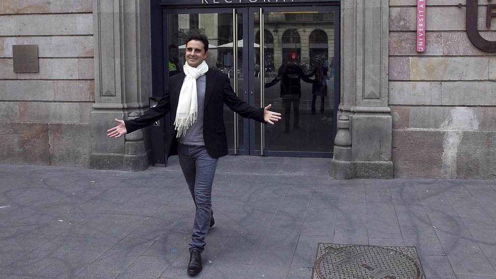 Hervé Falciani gestures after casting his vote in European elections in Barcelona on May 25, 2014
