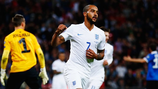 Theo Walcott celebrates scoring England's opening goal against Estonia at Wembley