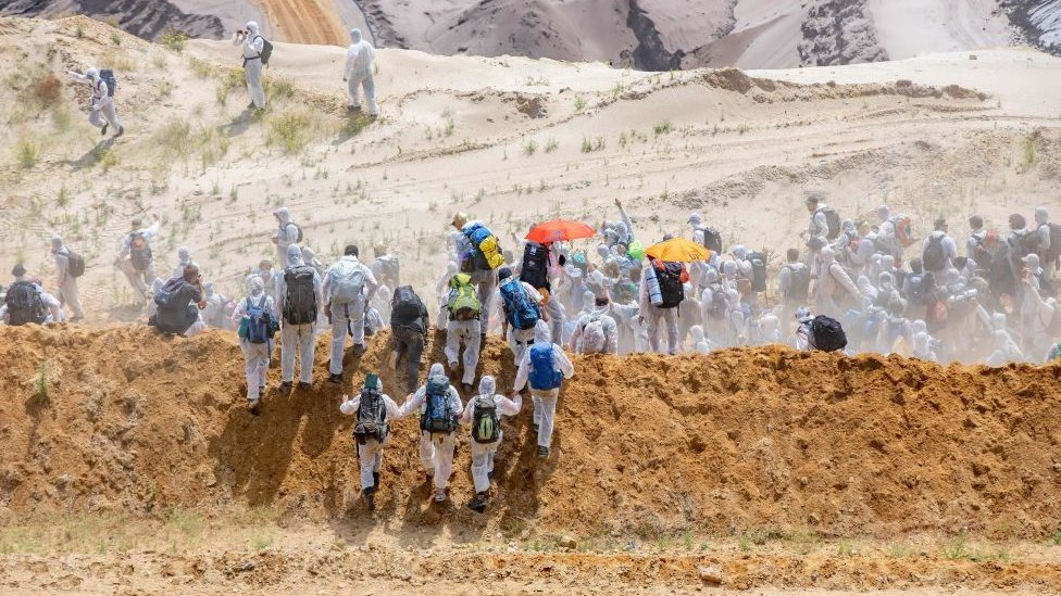 Activists run into the grounds of the mine