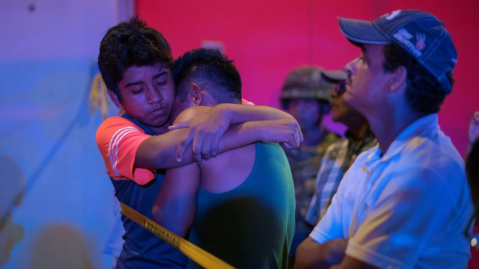 A man is comforted at a crime scene following a deadly attack at a bar by unknown assailants in Coatzacoalcos, Mexico August 28, 2019.