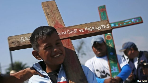Migrants arrive at the Basilica of the Virgin of Guadalupe while holding crosses during an annual human rights protest in Mexico City on 18 April, 2015