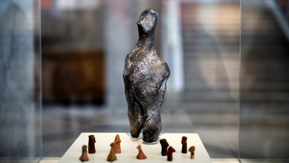 A 7,000-year-old Neolithic statuette on temporary show with bird-like clay figurines at the National Archaeological Museum in Athens, Greece, on 10 February 2017