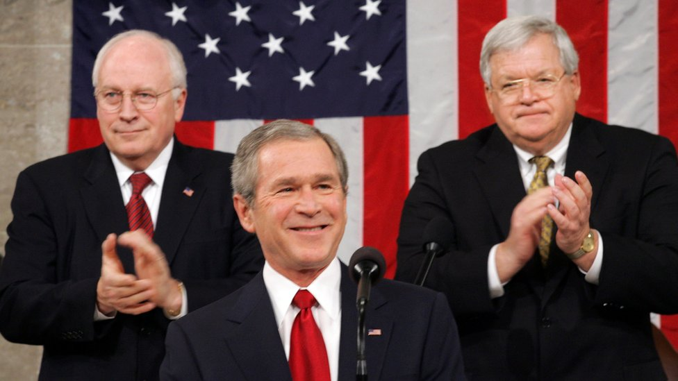 President George W. Bush at his annual State of the Union speech Wednesday, Feb. 2, 2005. He is applauded at rear by Vice President Dick Cheney, left, and Speaker of the House of Representatives Dennis Hastert