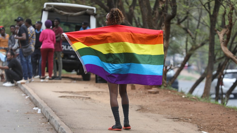 A member of Refugee Flag Kenya, an organisation that protects LGBT refugees and asylum seekers in Kenya poses for a photo during a demonstration outside the United Nations High Commissioner for Refugees (UNHCR), offices in Nairobi, Kenya, 13 May 2019.