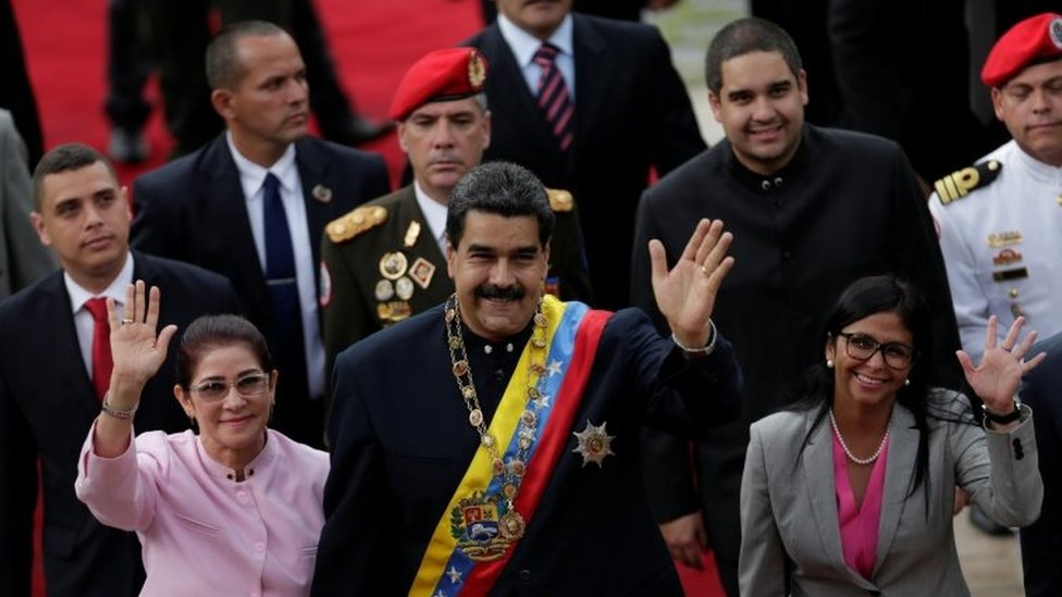 Venezuela's President Nicolas Maduro (C), his wife Cilia Flores (front L) and National Constituent Assembly President Delcy Rodriguez (front R), wave as they arrive for a session of the assembly at Palacio Federal Legislativo in Caracas, Venezuela August 10, 2017.