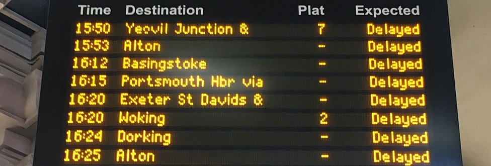"""An electronic rail departures board showing all trains are """"delayed"""""""