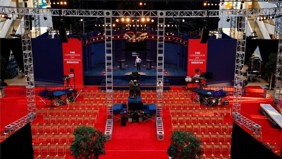 A worker inspects the debate stage