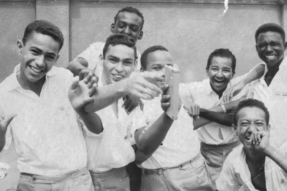 Boys smiling at the camera