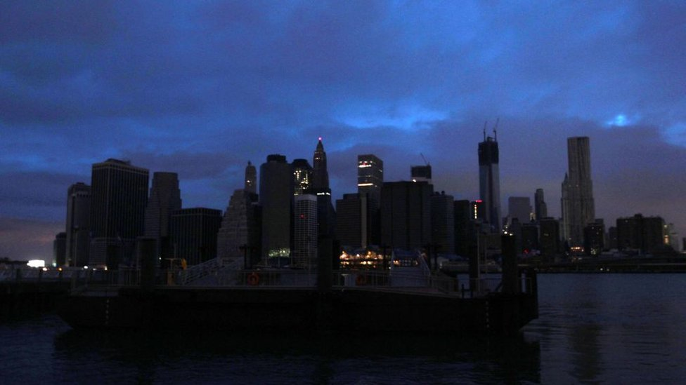 The darkened skyline of lower Manhattan is seen one day after Hurricane Sandy on October 30, 2012