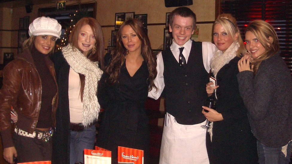 Girls Aloud with BBC reporter Steven McIntosh