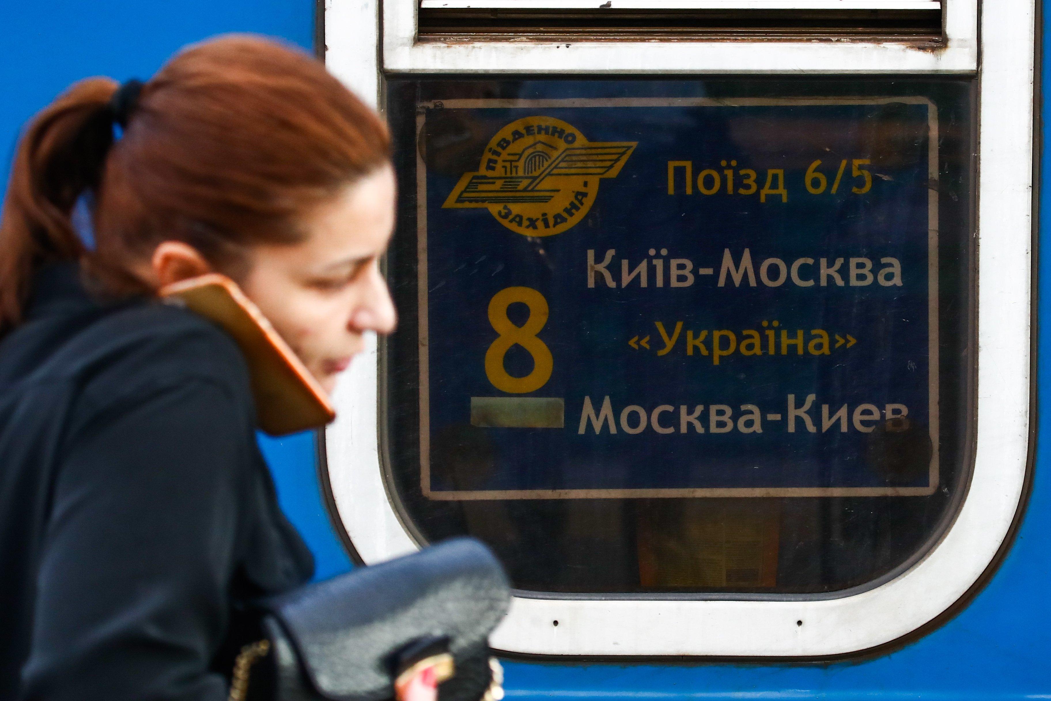 A woman walks by a Kiev-Moscow train in Kiev. File photo