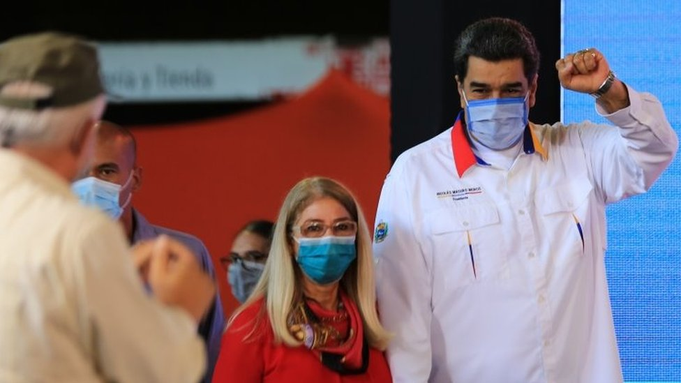 A handout photo released by Miraflores Presidential Palace shows Venezuelan President Nicolas Maduro (R) accompanied by First Lady Cilia Flores arriving to a government act in Caracas, Venezuela, 20 November 2020