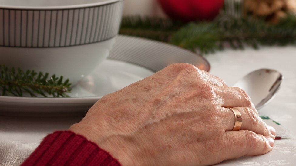 elderly lady eating Christmas lunch