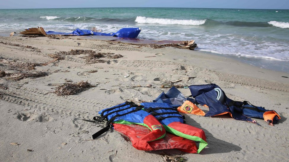Life jackets washed up on a beach after dozens of migrants drowned in a shipwreck off the Libyan coast of on September 21, 2017